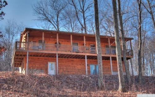 1 - Exterior Shot of Back of Property showing Raised Deck