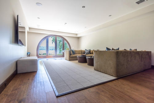 Lower Level Family Room with Arch Door way leading to lake.