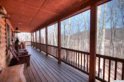 8 - Exterior Shot from Covered Deck Showing Mountain View in Winter